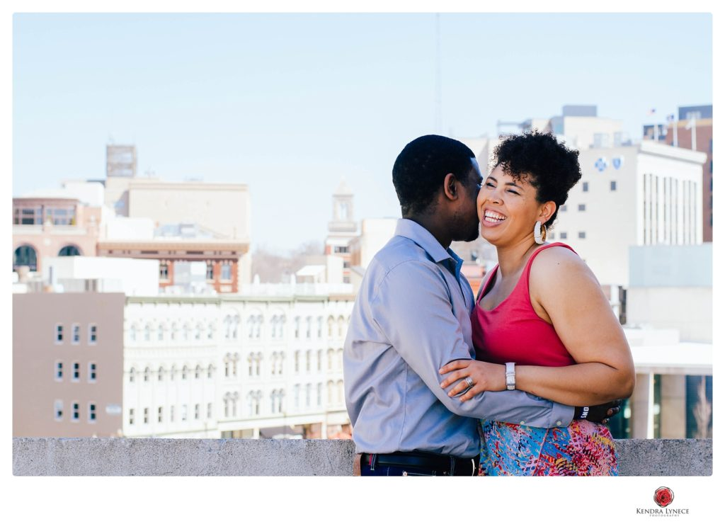 the city of downtown grand rapids engagement photos locations on a rooftop destination wedding photographer kendra lynece michigan wedding photography